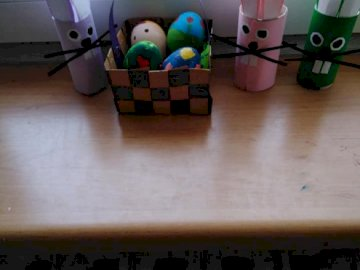 Nikola's holiday bunnies - Arrange Nikoli's Christmas bunnies. A wooden table.