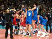 Serbia's volleyball team - Serbia's volleyball team. A group of people on a court.