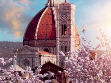 Florence buildings. - Puzzle: Florence buildings. A large brick building with a clock tower.