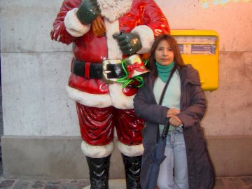 Antonieta in Montmartre - She is smaller than Santa Claus!. A person standing in front of a building.