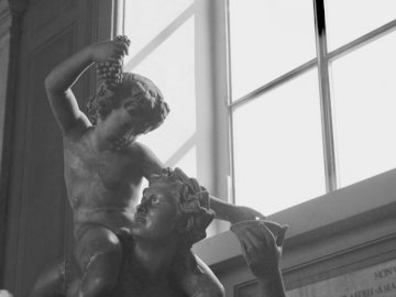 Do u want some grapes? - Grayscale of statue. Rome. A statue of a person.