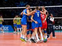 Serbia's volleyball team - Serbia's volleyball team. A group of people playing football on a court.