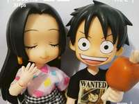 Luffy och Boa Ancock - Boa Ancock är kär i Luffy D. Monkey. En hand som håller en leksaksdocka.