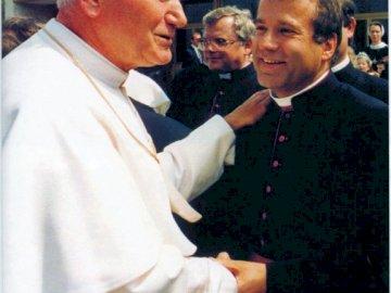 St. John Paul II in Poland again - St. John Paul II in Warsaw. Pope John Paul II in a suit and tie.