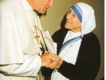 St. John Paul II with his mother Teresa of Calcutta - St. John Paul II also met with mother Teresa of Calcutta. Mother Teresa standing in a room.