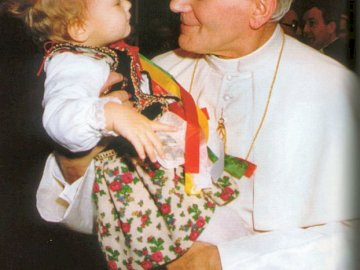 St. John Paul II loved young people and children - St. John Paul II loved young people and children. A person holding a baby.