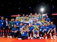 Slovenia's volleyball team - Slovenia's volleyball team. A group of people standing in front of a crowd posing for the camer