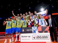 Slovenia's volleyball team - Slovenia's volleyball team. A group of people standing on a stage.