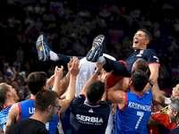 Serbia's volleyball team - Serbia's volleyball team. Slobodan Kovač et al. standing in front of a crowd.