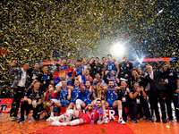 Serbia's volleyball team - Serbia's volleyball team. A group of people standing in front of a crowd.