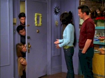 Friends series - This is a photo of the characters from the Friends series. A group of people standing in a room. Thi