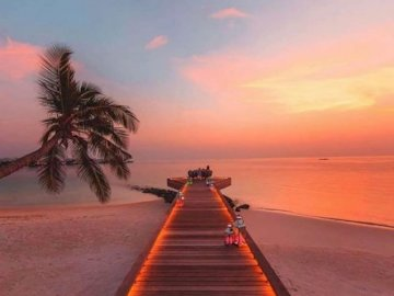Magical Maldives - oh oh oh oh oh oh oh oh oh oh. A sunset over some water.