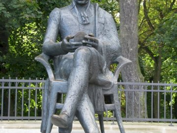 a statue of Zygmunt Krasiński in Opinogóra - a statue of Zygmunt Krasiński in Opinogóra. A statue of a man sitting on a bench.