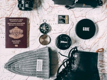 Travel must haves - Travel, adventure, must haves. A variety of items on a table.