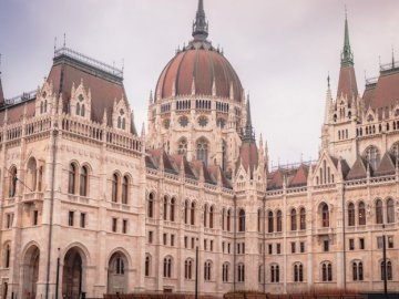 Budapest, Hungary - Budapest, Hungary, photo. A large building with Hungarian Parliament Building in the background.