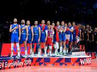 Serbia's volleyball team - Serbia's volleyball team. A group of people standing in front of a crowd posing for the camera.