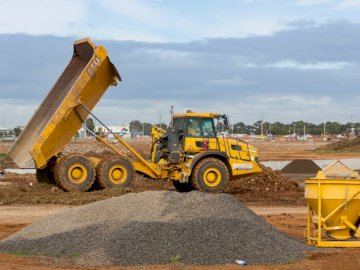 Roads construction site. - Yellow and black heavy equipment on brown dirt field during daytime. Melbourne, Australia.