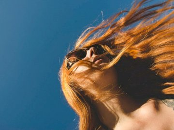 International Women's Day - Woman with long red hair. Switzerland. A close up of a woman.