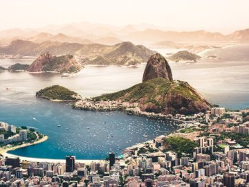 Rio de Janeiro, Brazil - Rio de Janeiro, Brazil, photo. A large body of water with a mountain in the background.