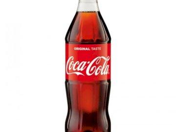 cols de coca - esto es coca cola espero que todo salga muy facilmente. A close up de una botella.