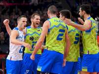 Slovenia's volleyball team - Slovenia's volleyball team. A group of people standing in front of a crowd.