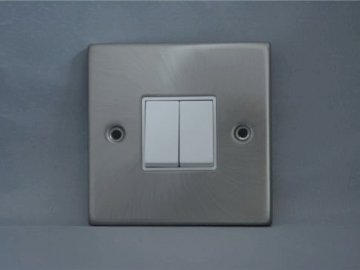 Light switch - A light switch that is alone and ready to be solved. A close up of a door.