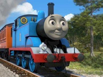 tomek ania i klara - tomek ania i klara spoko puzzle. Zabawkowy pociąg na torze, z którego wydobywa się dym.