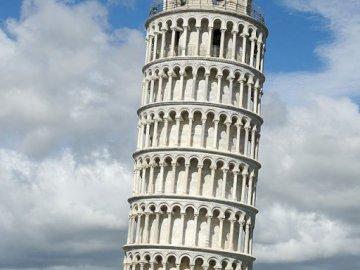 zagadka zagadkowa fajna zagadka - przedstawia krzywą wierzę w Pizie. Lubię piccę. Duża wysoka wieża na tle nieba z Krzywą Wież