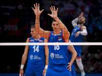 Serbia's volleyball team - Serbia's volleyball team. Marko Podraščanin holding a racket.
