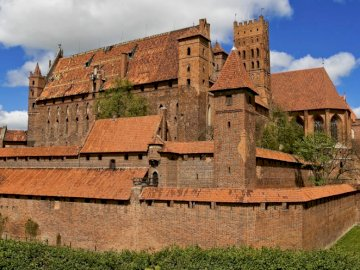 Historical building - The most famous castle of the Teutonic Order. A stone castle next to a brick building with Malbork C
