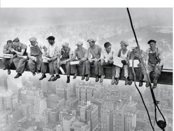 LUNCH TIME NY - Construction of a skyscraper in New York. A group of people posing for a photo.