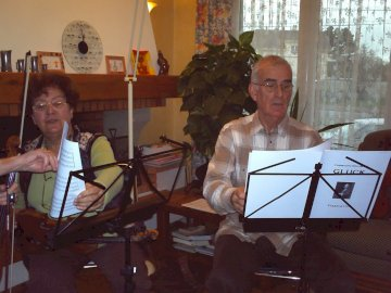 Marie-Andrée & Jean-Louis - They play chamber music. A person sitting at a table.