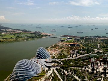 Panorama of Singapore - ================================. A body of water with a city in the background.