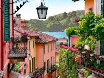 The Bellagio. - A small street on Lake Como in Bellagio. A house with bushes in front of a building.