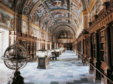 The most beautiful libraries in the world - The Escorial Library in Madrid, Spain. A large building with many windows.