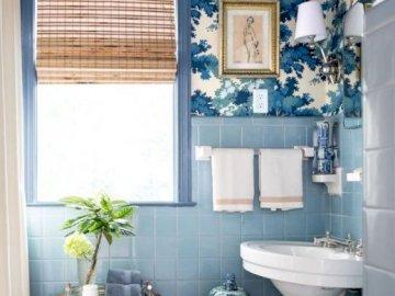 Blue in the bathroom - An idea for a blue bathroom. A white sink sitting under a window.
