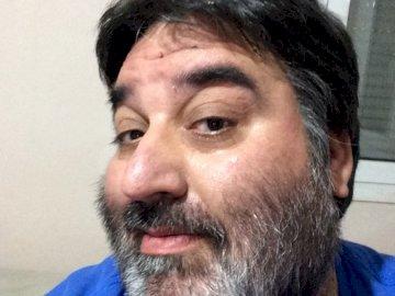 Thomagoras - Make Thomagoras. ancient computer philosopher. A man wearing a blue shirt and smiling at the camera.