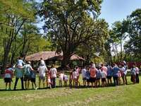 Day Center - Let's see who can put together this puzzle!. A group of people standing next to a tree.