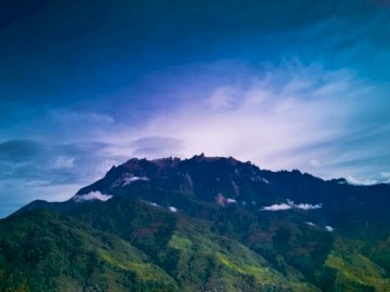 This is Mount Kinabalu! It is - Mountains during daytime. Miri, Sarawak, Malaysia. A large mountain in the background.