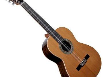 Żabko, haz un rompecabezas, ¿qué es este instrumento musical? - Organiza los rompecabezas correctamente. A cerca de una guitarra.