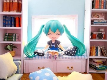 Miku in his room - Miku is in his room full of books. A girl holding a book shelf.
