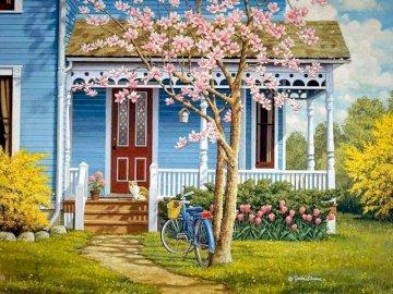 umore primaverile - dintorni di primavera della casa. Una bicicletta parcheggiata di fronte a un edificio.