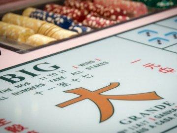 Casino Games, Macau, China - White and orange labeled box. Macau. A close up of text on a white surface.