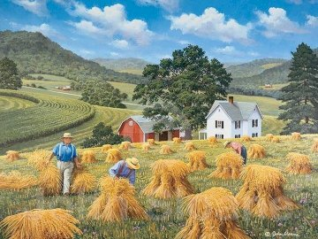 Field work. - Rural landscape. Harvest. A group of people in a field with a mountain in the background.