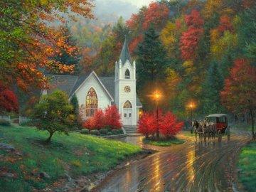Autumn landscape. - Autumn trees. Illuminated Church. A view of a city street.