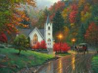 Autumn landscape. - Autumn trees. Illuminated Church. A view of a city street.