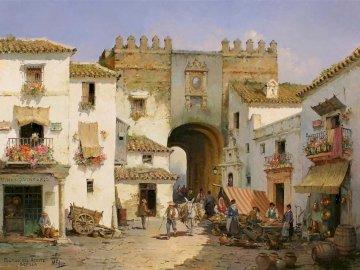 Entrada con arco - Entrada con arco de un pueblo andaluz. Grupa ludzi stojących przed budynkiem.