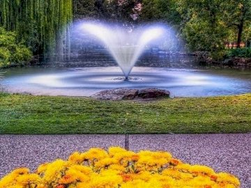 A fountain in the park. - Puzzle: a fountain in a nice park.
