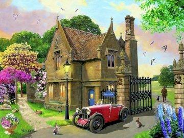 Residencia en un hermoso jardín. - Una residencia con un jardín de hermosas flores. Una pequeña iglesia en un jardín.