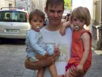 back from school - a happy family. A little girl holding a baby.